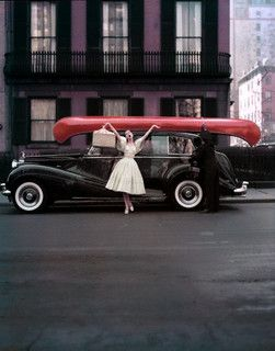 My angler husband would adore it if I returned home from a day of fishing with a canoe strapped to the roof of the car like this! :) #vintage #1950s #fashion