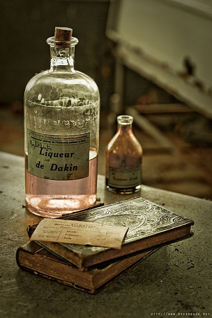 Glass bottles and books