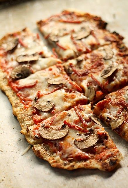 Rustic, delicious looking Gluten free grilled flatbread pizza with mushrooms. #food #gluten_free #cooking #pizza #meals #dinner #lunch