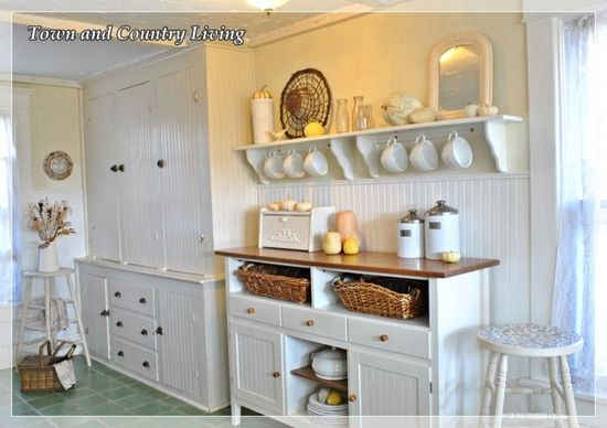 Freestanding cabinets and open shelving, with beadboard features gives this kitchen that country farmhouse charm.