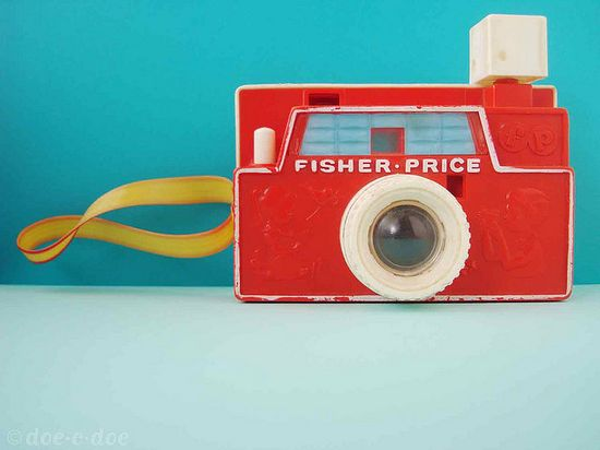 A toy camera by Fisher Price ...
