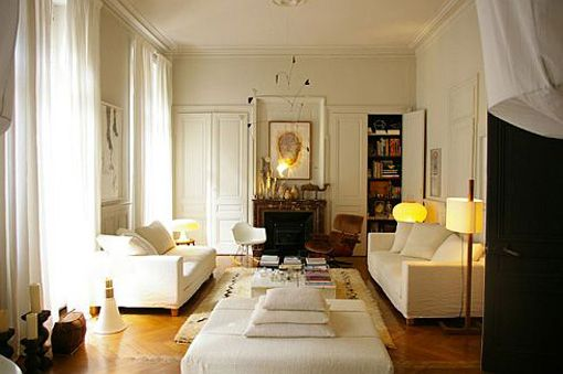 Golden floors brown fireplace white furniture