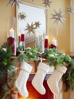 Christmas Mantel #mantel #christmas #stockings #ornaments #evergreen #cylinders #candles