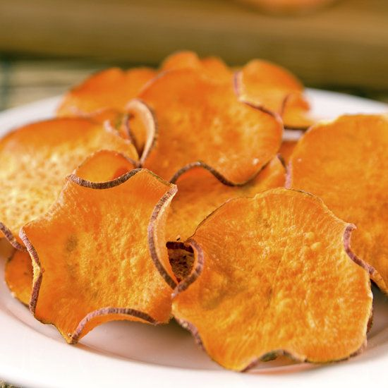 Sweet Potato Chips  slice sweet potatoes thinly on a mandolin slicer, toss the slices in one teaspoon of olive oil, lay them out on a cookie sheet, sprinkle them with salt, and bake at 400 degrees for 20-25 minutes, flipping once!!