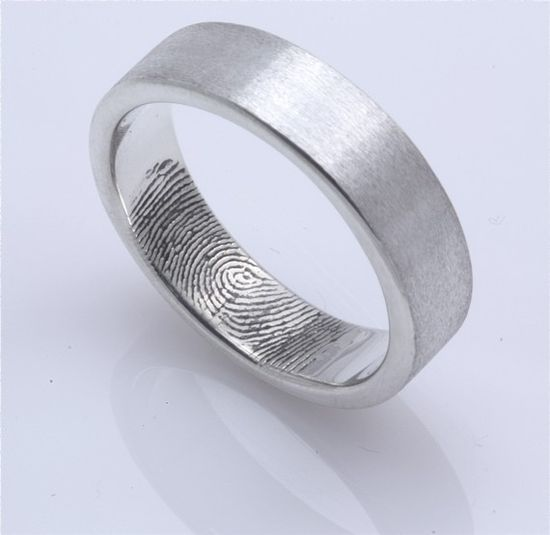 Her fingerprint inside his band! I'm in love with this idea.