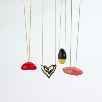"Marlene Beyer – Germany – Necklaces  'Dildo series' – Polyester resin, pigment, partly metalized, silver, gold plated silver  CONSOLATION"" PRIZE FOUNDED BY SIC GROUP (BOGUMIŁ BYTOMSKI, PAWEŁ KACZYŃSKI,  KRZYSZTOF ROSZKIEWICZ, MARCIN TYMIŃSKI, AREK WOLSKI)"