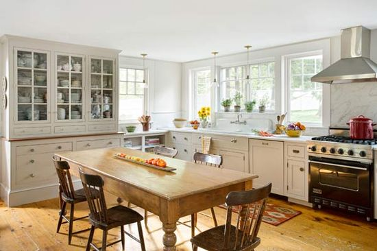 lots of windows instead of upper cabinets, built-in hutch for storage . . .