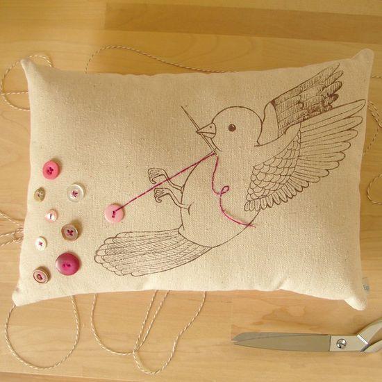 Bird pulling the thread. I love this.