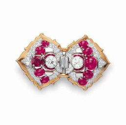 A RUBY AND DIAMOND CLIP BROOCH, BY CARTIER