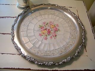 broken china and silver tray
