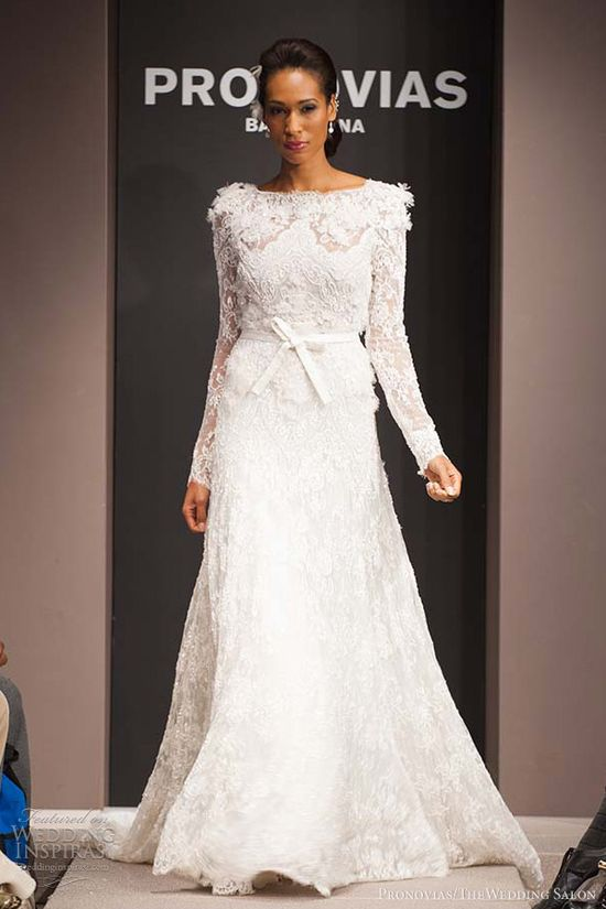 Loving the full length lace sleeves. Pronovias.