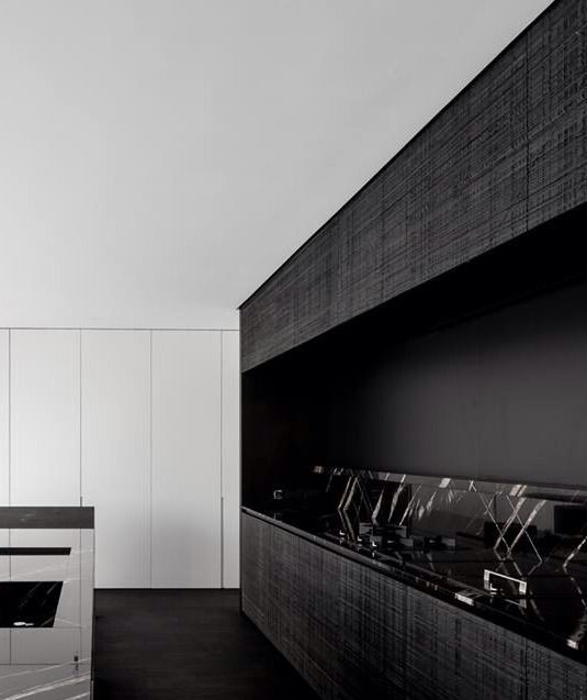 Marble and wood kitchen interior by Pascal Francois Architects.
