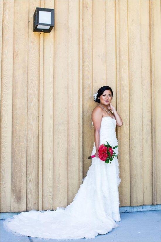 Real bride Jodi in a ruffled Tadashi Shoji gown. Love her bright bouquet!