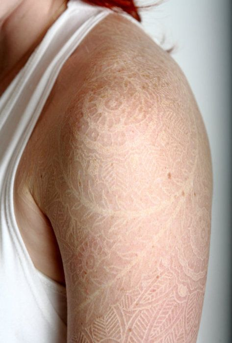 white ink tattoo,intricately detailed, like lace.
