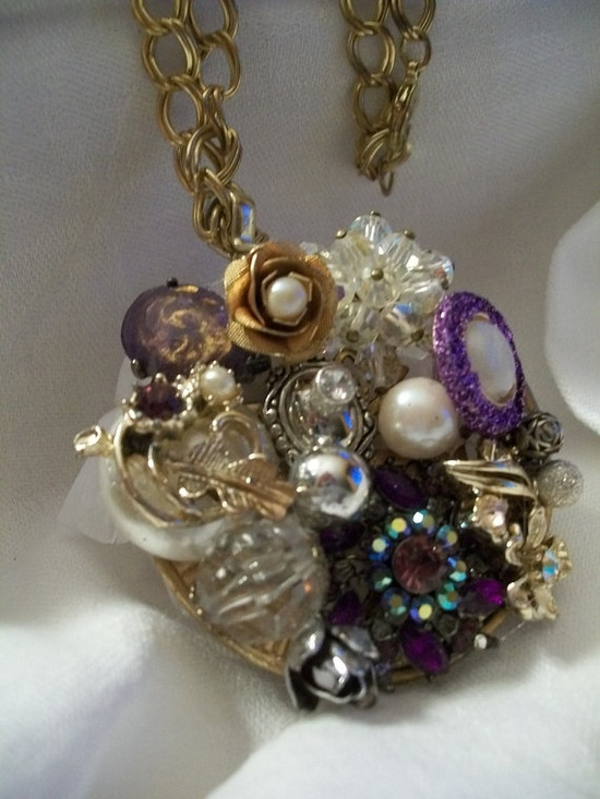 vintage jewelry all stuck together. Create your own pendent or brooch from vintage jewelry