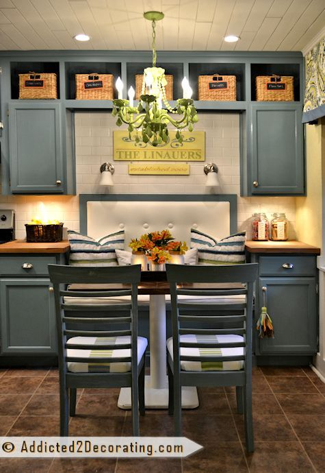 I love the cabinets going to the ceiling and then the cubbies at the top. way more useable than open space above cabinets that just collect dust.    Beautiful Condo Breakfast Room Makeover – Before and After via @Kristi @ Addicted 2 Decorating