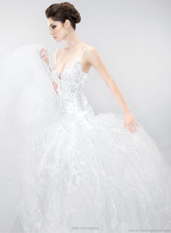 Beautiful wedding gown decorated with Swarovski crystals by Julia Kontogruni #somethingsparkling