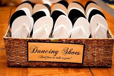 every woman knows that when the dancing starts the heels come off. a basket of flip flops is a great idea for your lady guests to dance the night away!