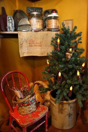 Primitive Christmas....love the tree & chair together!!!
