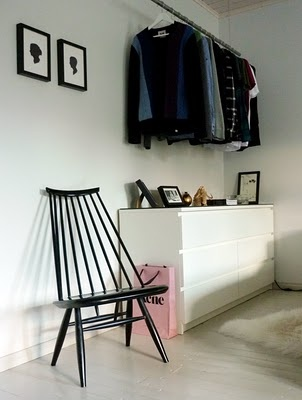 Loving so many things about this: silhouettes are so hot, fabulous chair, and the minimalist clothes rack?! LOVE.