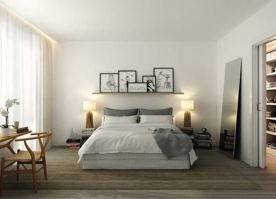 White and gray bedroom. Like the shelf above the bed with the frames.
