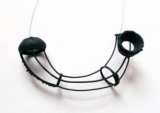 Carolina Giner    Structure and emptiness series - Piece II (2013). Pendant    Nickel silver, black porcelain and steel wire    50 x 100 x 30 mm
