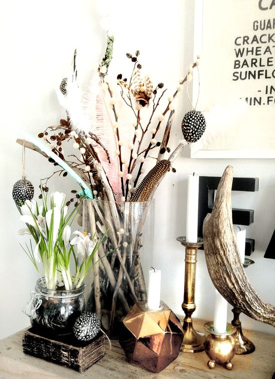 a glass with a mix of collected feathers and sticks... makes a great accessory.