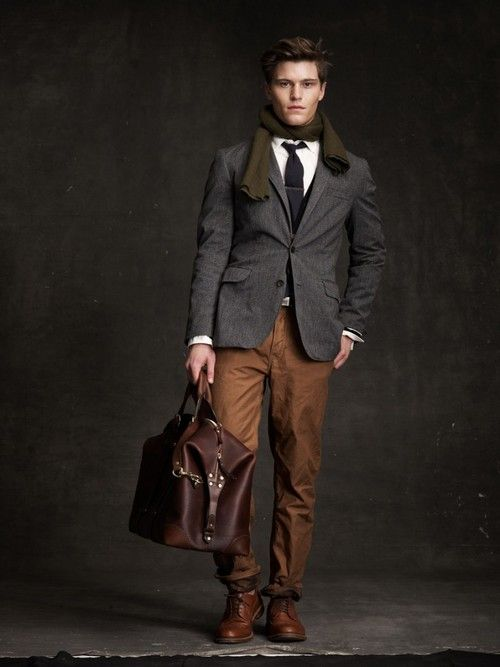 Gray Wool Jacket, Brown Chinos, Tie, and Leather Mans Duffle. Men's Fall/Winter Fashion.