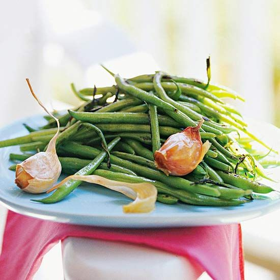Toss green beans on the grill, then serve them with lemon-flavored olive oil and garlic.