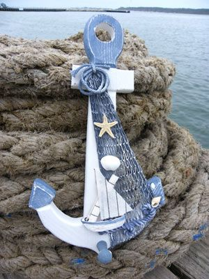 Rustic decorative items for a nautical home in the UK. Sea themed decor and coastal decor in a nautical home, seaside bathroom, garden or boat including anchor gifts and ship's wheel.