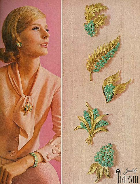 Model Angela Howard shows off some of Trifari's lovely early 60s brooches. #vintage #jewelry #brooch #pin #1960s