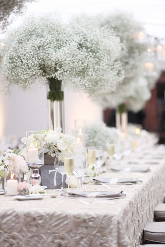 love the texture on this tablecloth and the way that the baby's breath arrangements look like cotton, only more romantic