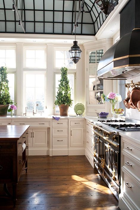 love the greenhouse style ceiling and rustic floors