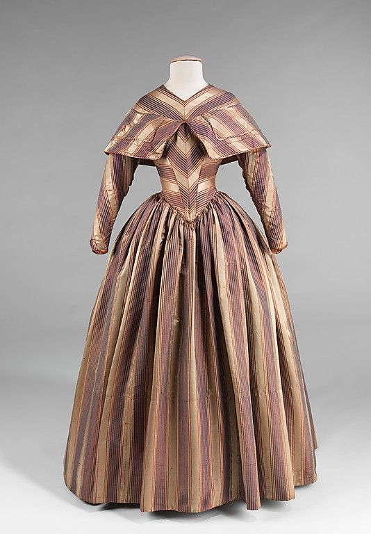 Dress, Visiting    Date:      1845–50  Culture:      American  Medium:      silk  Dimensions:      Length at CB: 56 in. (142.2 cm)  Credit Line:      Brooklyn Museum Costume Collection at The Metropolitan Museum of Art, Gift of the Brooklyn Museum, 2009; Gift of Annie M. Colson, 1929  Accession Number:      2009.300.630