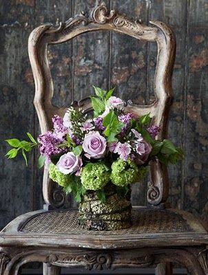 Powerfully gorgeous... #pink #purple #green #roses #vintage #arrangement #flowers #wedding #antique #chair