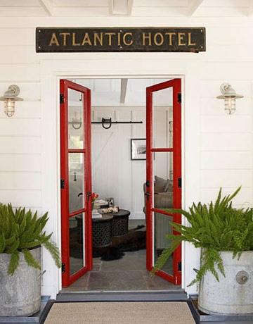 red door + galvanized buckets + sconces