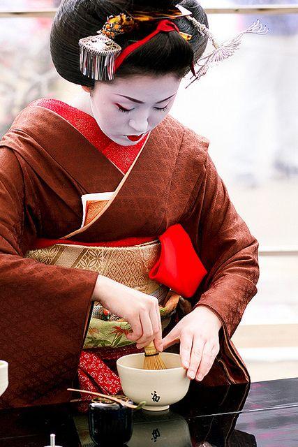 Geiko performing tea ceremony at Plum blossom festival in Japan