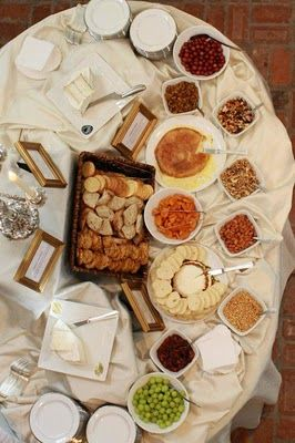 Gourmet Cheese Station: a variety of  Cheeses, with Gourmet Breads, Crackers, Fruits, Nuts, and Chutnies.