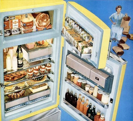 Just look at all those (now empty) bags of groceries she was able to get in her cheerfully buttercup hued Hotpoint fridge. #vintage #1950s #fridge #kitchen #home #decor #homemaker #housewife #groceries