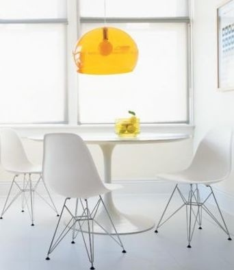 White dining room: Tulip table, Eames chairs