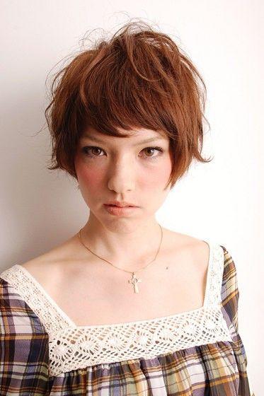 cute short hair...she looks a little scary