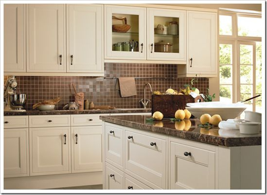 """Good to know! """"Here's another kitchen with creamy cabinets and chocolate brown stone counters with the brown continuing on the backsplash. Please, what ever you do, do not paint your cabinets screaming white if you are going for a brown counter and backsplash, it will [almost] look like a white 90's kitchen with new brown granite. Your cabinets must be cream or beige with this much brown. White on white is way too stark!"""""""