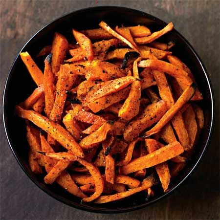 Spicy Sweet Potato Fries: With only 106 calories per serving, this super-easy baked alternative to french fries gets a flavorful kick from cayenne pepper, smoked paprika, and salt.