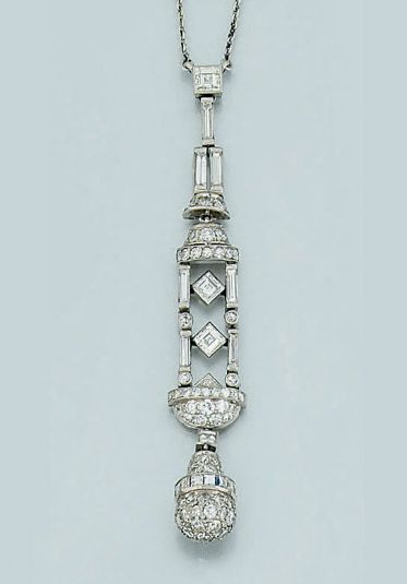 An Art Deco diamond pendant necklace   The diamond pendant of stylised lantern design, composed of articulated links of baguette diamonds with pavé diamond detail above and below, suspending a pavé diamond pear-shaped drop with square-cut diamond band detail to a platinum neckchain, circa 1925