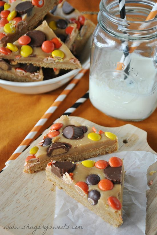 Peanut Butter Cookie Bars- triple layer #peanutbutter bars with Reese's cups and pieces! #dessert www.shugarysweets...