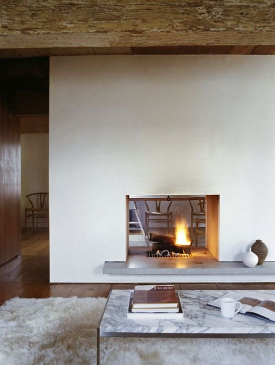 i love the open fireplace between rooms!