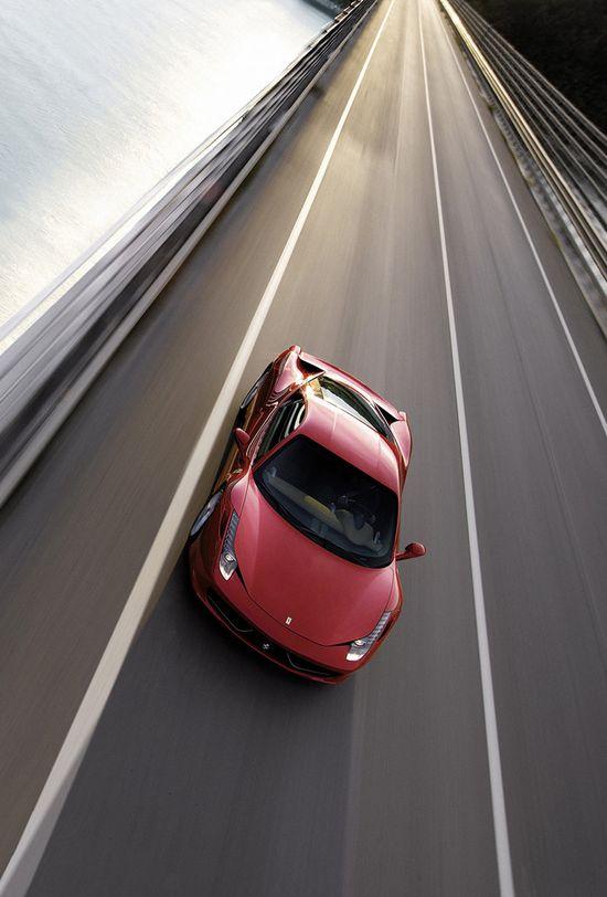Ferrari 458 Italia cruising via carhoots.com