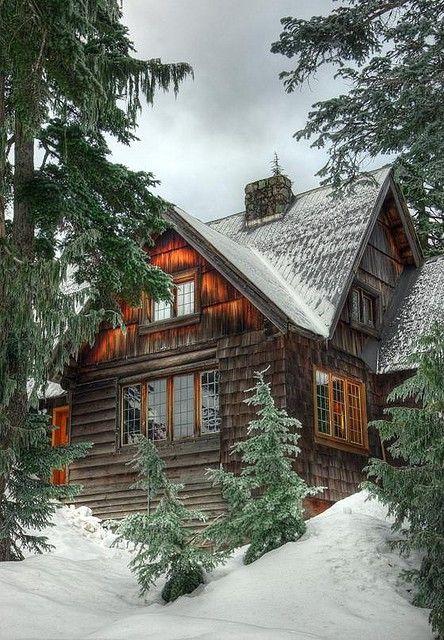 Beautiful log cabin in the snow.