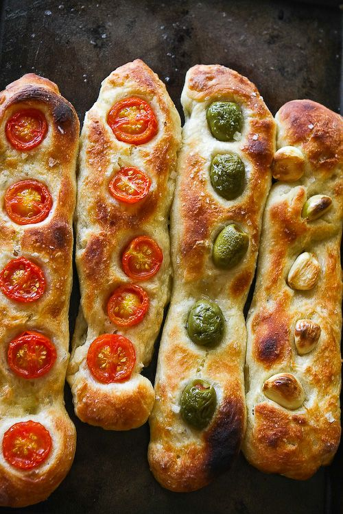 Easy homemade baguette bread with tomatoes, olives or garlic embedded