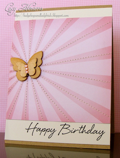 handmade birthday card ... light and dark pink sunburst design ... small wood layered butterfly in the sun's spot ... luv the machine sewn lines down the middle of each dark sunburst ... great idea to give dimension so and otherwise flat card ... lovely in pink ...